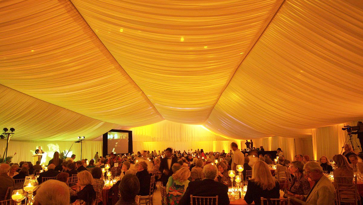The Rainier triple rail Event tent structure offers stability width to accommodate large crowds but it raises the ceiling along the edges