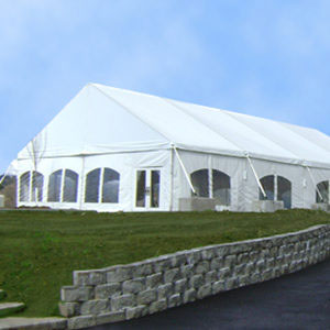 Large white event tent on grass